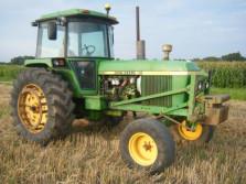 JOHN DEERE tractor (type 4230, 125 pk) met Planisol
